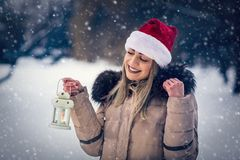 Girl on winter forest with lantern –winter holidays, Christmas stock photo