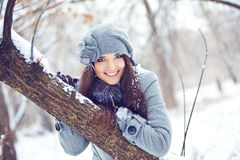 Girl in winter forest Royalty Free Stock Photo