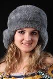 GIRL IN WINTER FUR-CAP. BEAUTIFUL GIRL IN WINTER FUR-CAP Royalty Free Stock Photos