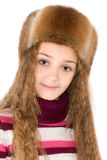 The girl in a winter fur-cap Royalty Free Stock Photos