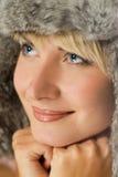 Girl in winter fur-cap Royalty Free Stock Image