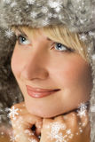Girl in winter fur-cap Stock Images