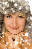 Girl in winter fur-cap Stock Photography