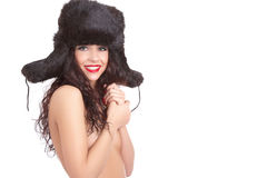 Girl in winter fur cap with ear-flaps Stock Photo