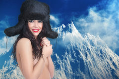 Girl in winter fur cap Stock Image