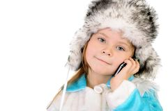 The girl in a winter fur cap speaks by phone Stock Photo