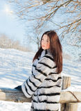 Girl in winter fur coat on the nature Stock Photos