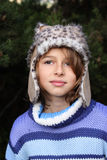 Girl in winter hat. Teenage child dressed in a leather hat with furry trimming Royalty Free Stock Images