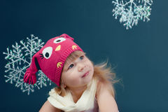 Girl in winter hat framed by snowflakes Royalty Free Stock Photos
