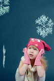 Girl in winter hat and gloves framed by snowflakes Stock Photos