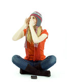 Girl in winter hat shouts Royalty Free Stock Image