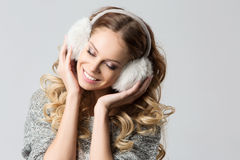 Girl with winter headphones Royalty Free Stock Image