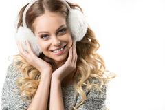 Girl with winter headphones Stock Photography