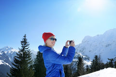 Girl in winter mountains Stock Images