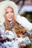 Girl in winter park Stock Images