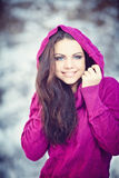 Girl in Winter Park. Beautiful girl in winter park and crimson sweater smiles Royalty Free Stock Photos