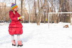 Girl in a winter park stock photo