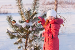 Girl in winter park Royalty Free Stock Photo