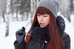 Girl in winter park with glasses Royalty Free Stock Image