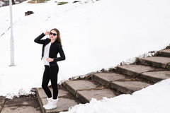 Girl in winter park in sunglasses and jacket Stock Photography