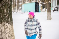 Girl winter plays in the snow royalty free stock images