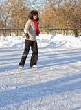 Girl on winter skate rink Stock Photography