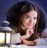 Girl on winter snow stock photo