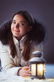 Girl on winter snow with lantern royalty free stock photography