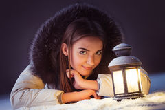 Girl on winter snow with lantern Royalty Free Stock Image