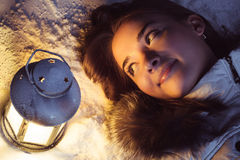Girl on winter snow with lantern royalty free stock photos