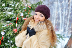 Girl in winter snows, in a mink coat outdoors Stock Photography