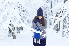 Girl in winter snowy forest Stock Images