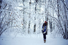 Girl in winter snowy forest Stock Image