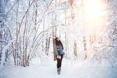 Girl in winter snowy forest Stock Photo