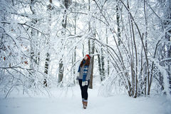 Girl in winter snowy forest Stock Photos