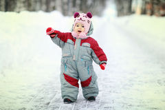 Girl on a winter snowy road Stock Images