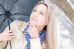 Girl in winter street Royalty Free Stock Image