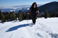 Girl winter trekking in the snow Stock Images