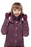 Girl in winter violet hooded jacket Royalty Free Stock Photos