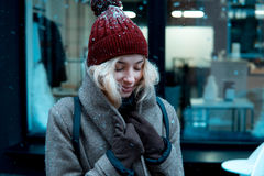 Girl on a winter walk in the city, snow, outside. Winter street in the city Royalty Free Stock Photography