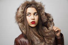 Girl in winter warm hood Stock Images
