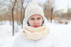 The girl in a winter white down-padded coat Stock Image