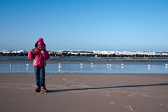 Girl on winter windy beach Royalty Free Stock Images