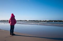 Girl on winter windy beach Stock Photo