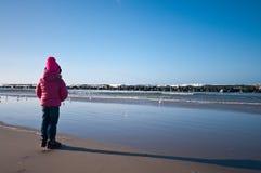 Girl on winter windy beach Stock Photo