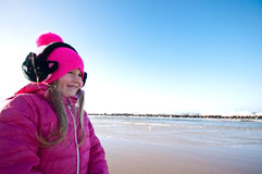 Girl on winter windy beach Stock Images