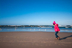 Girl on winter windy beach Royalty Free Stock Photography