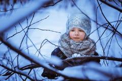 Girl in winter woods stock photos