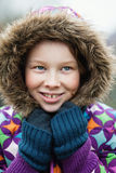 Girl in winther clothing. Outdoor portrait of girl wearing colorful jacket Royalty Free Stock Image