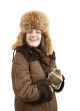 Girl  in wintry clothes. Girl in sheepskin coat and fox cap on white background Stock Photos